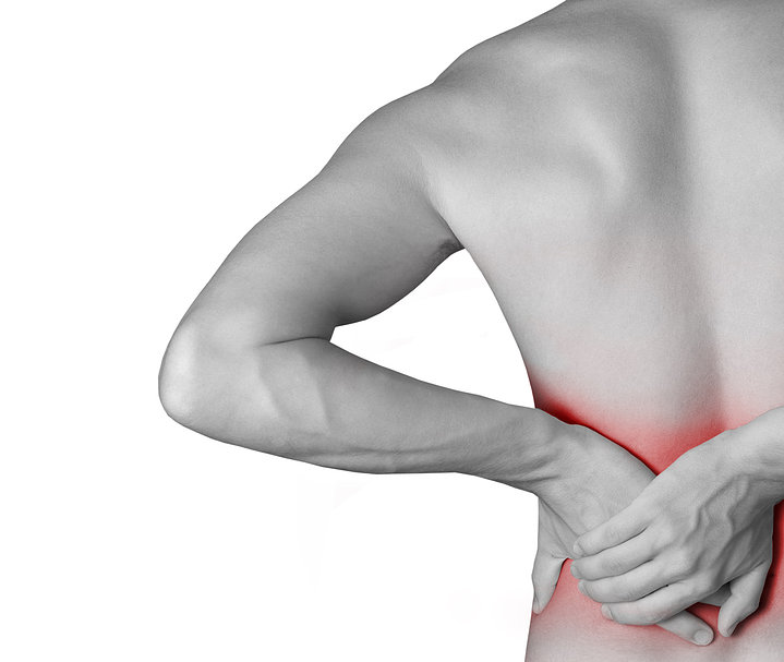 young male holding his back in pain